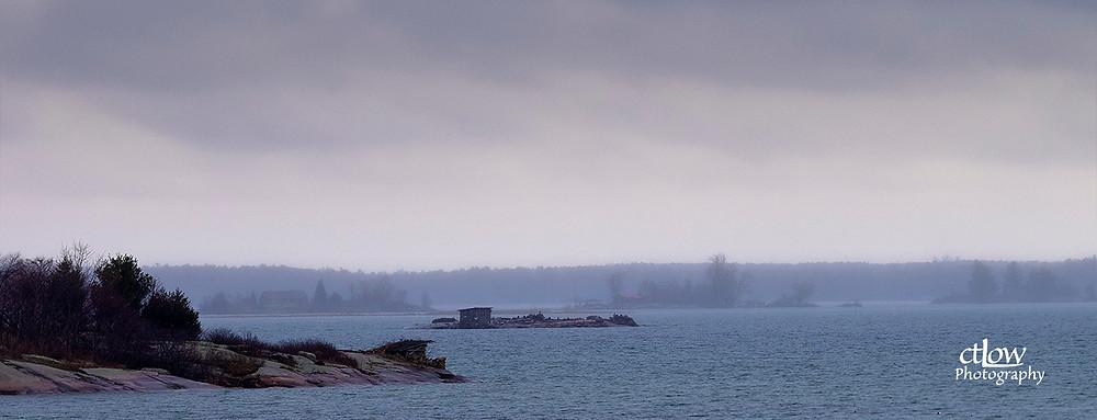 Thousand Islands rock hunting blind dusk rain