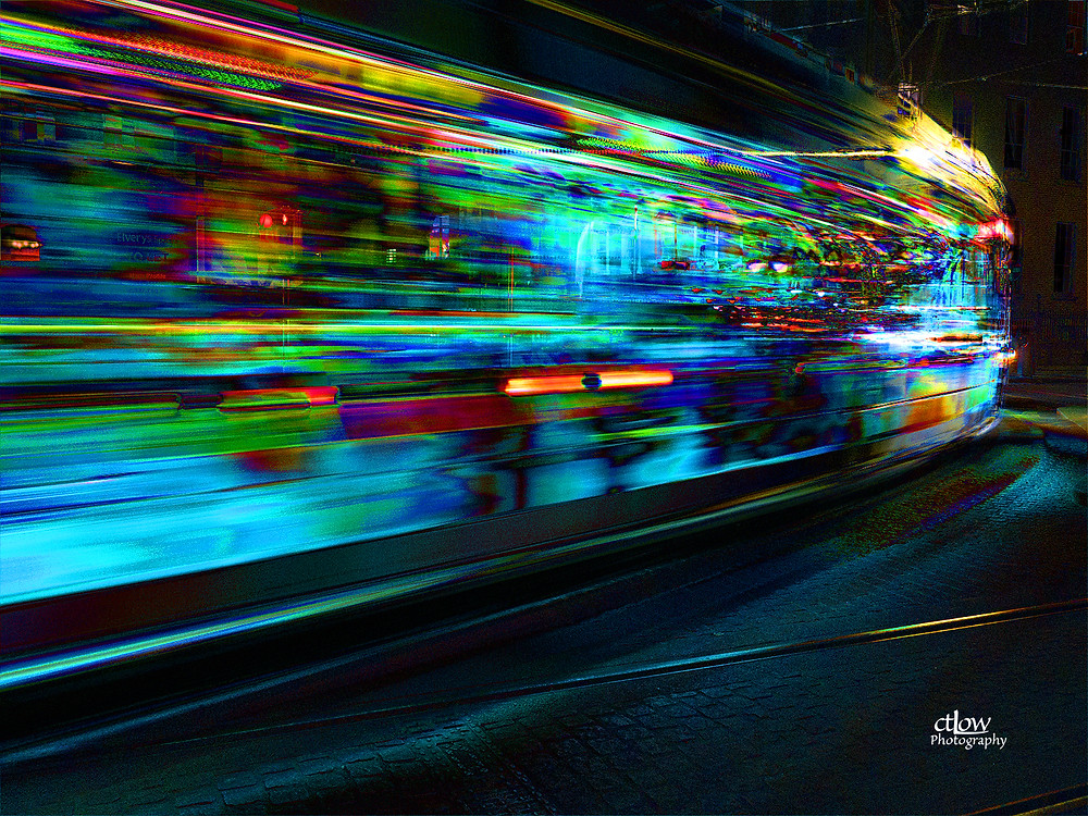 light rail train multiple night image overlay Dublin Ireland