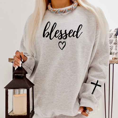 Blessed with heart and cross on the sleeve