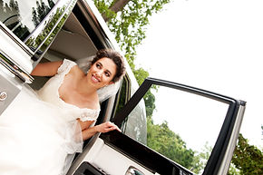 Bride exiting out of Rolls Royce Phantom