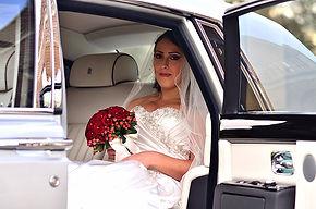 Bride siting in Rolls Royce Phantom
