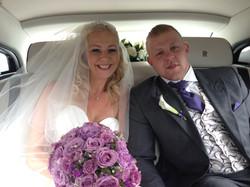 Bride and groom in rear of Phantom