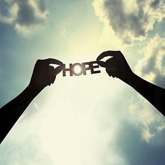 holding a paper cut of hope.jpg