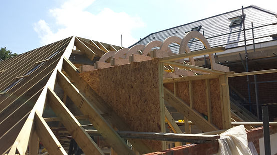 Large house Roof with curved roof dormer with living space.