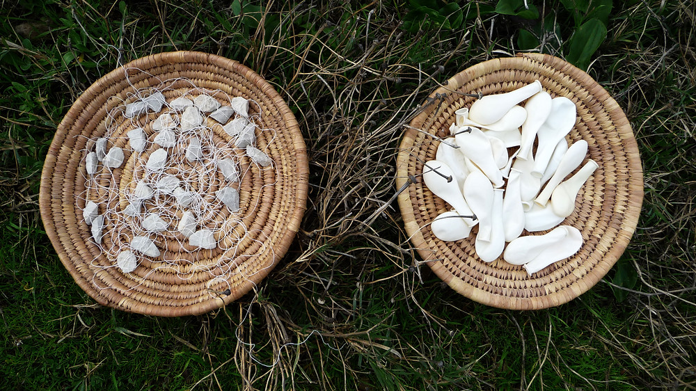 The offerings (white balloons,white stone, white yarn)