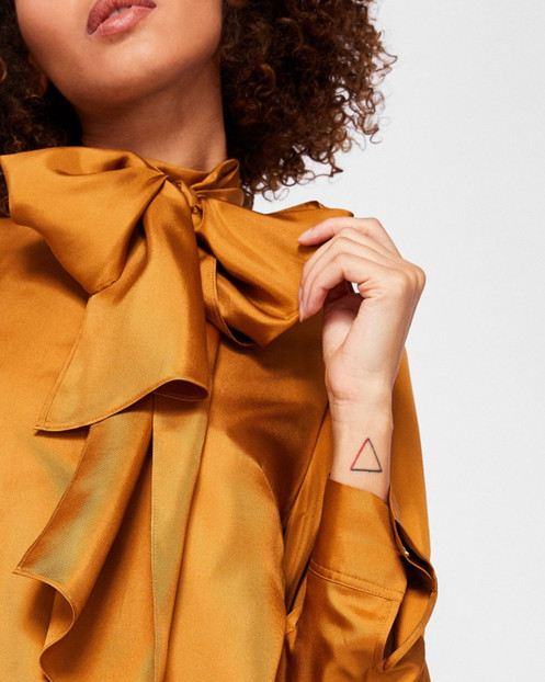 277a1658c5648c Make a sartorial statement with a little help from MARTHER. Ted s  diaphanous silk top comes trimmed with an elegant oversized neck tie that  can be worn in a ...