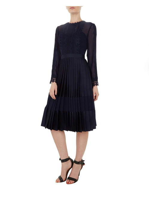 9118b498c8f Stand out at your next office party or other special social gathering with  this Ted Baker Looez dress.