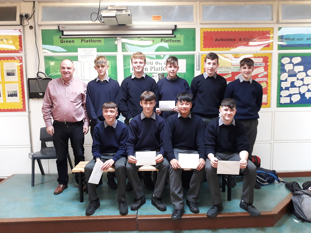 A group of last year's junior cert students join their year-head Mr. McLoughlin for a photograph.