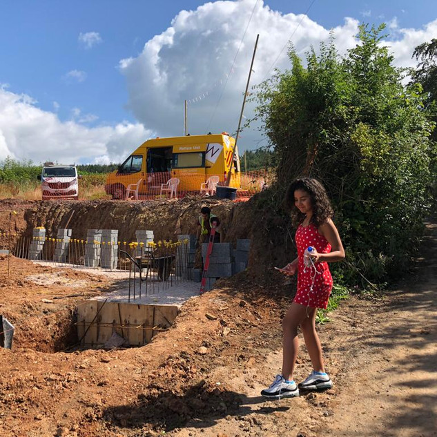 Demi visiting the hole in the ground before the build