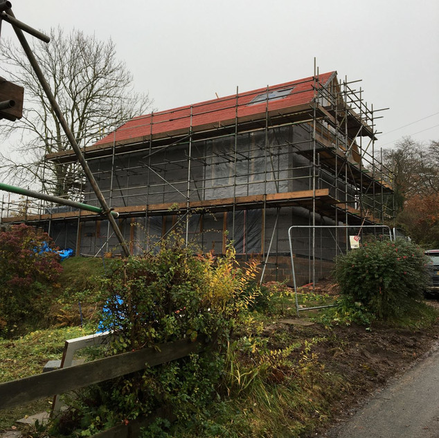 Roofing battens on and window openings protected