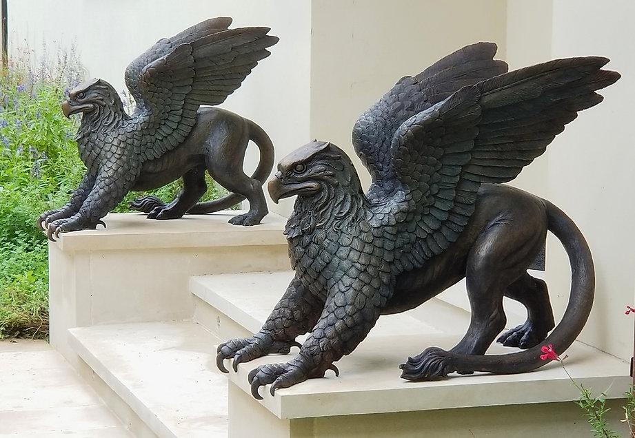 2 bronze gryphon sculptures