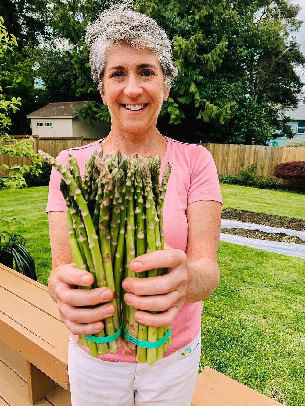 Carole holding asparagus