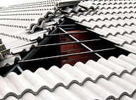telhado colonial de ferro com telha de cimento cinza