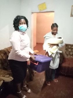 Mma Malese giving a baby box