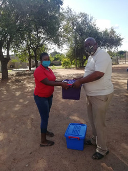Pastor Mogale giving out a baby box