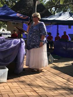Babrie leading prayers at Anti-Rhino Poa