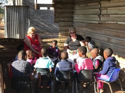 Rhi and Barbie teaching Sunday School Lu