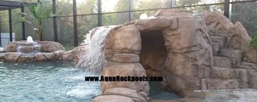 pool rock slide grotto waterfall 9
