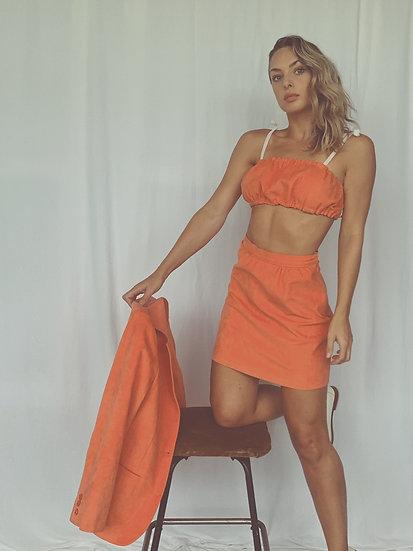 orange suede suit