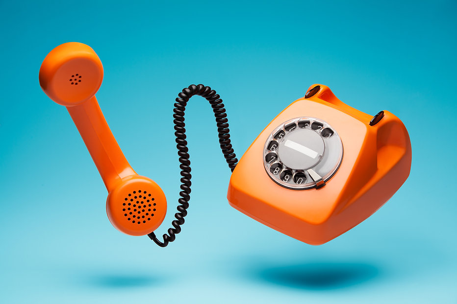 Old orange telephone rings with handset