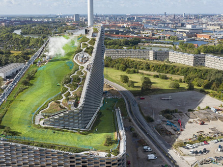 A look at the  Copenhill power plant topped with rooftop ski slopes!