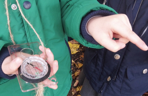 Using a compass to find north.