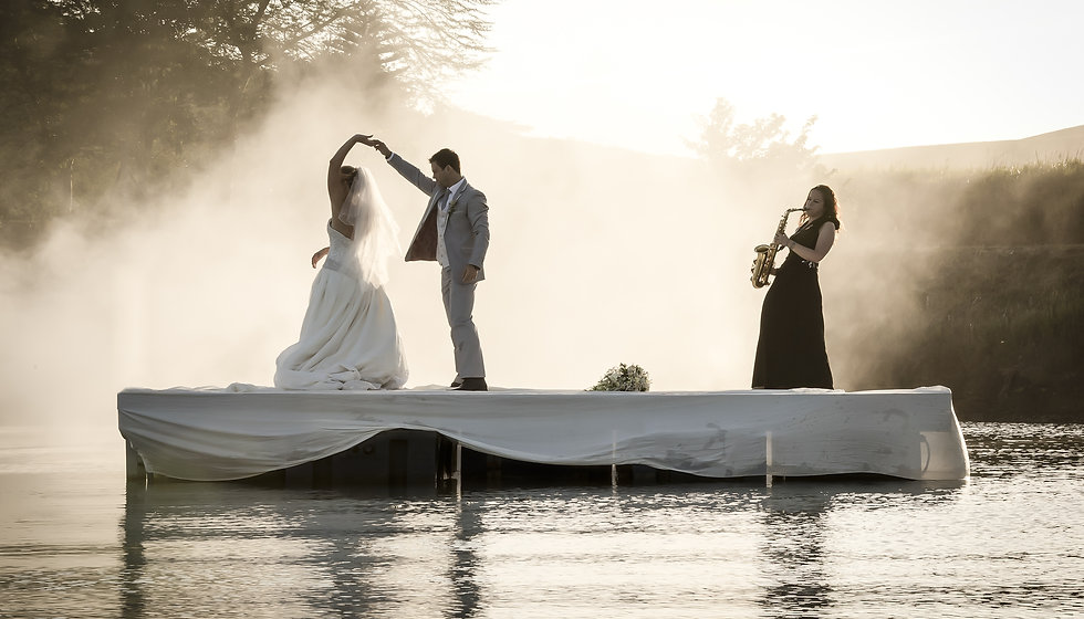 Bride and Groom dancing on a lake to mus