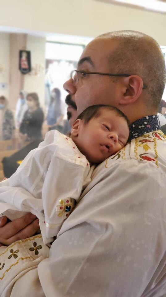 Youhanna Youssef and his newborn son
