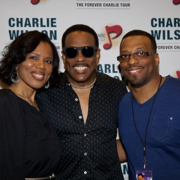 Marisa and her husband with Charlie Wilson