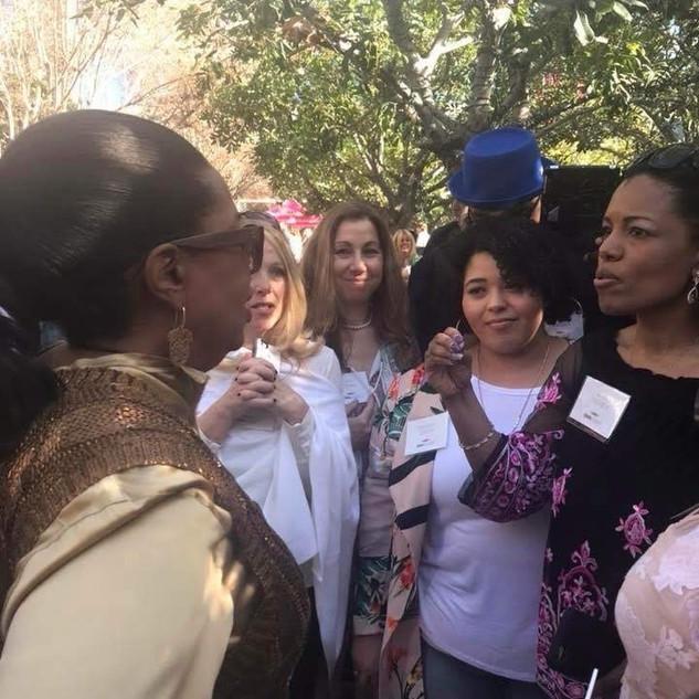 Marisa Tigney talking with Oprah at Oprah Winfrey Network