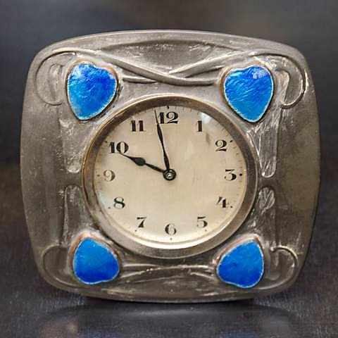 Tudric pewter clock with foil enamel hearts