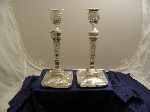 Adam style silver candlesticks