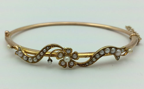 Victorian 18 ct gold and seed pearl bangle bracelet
