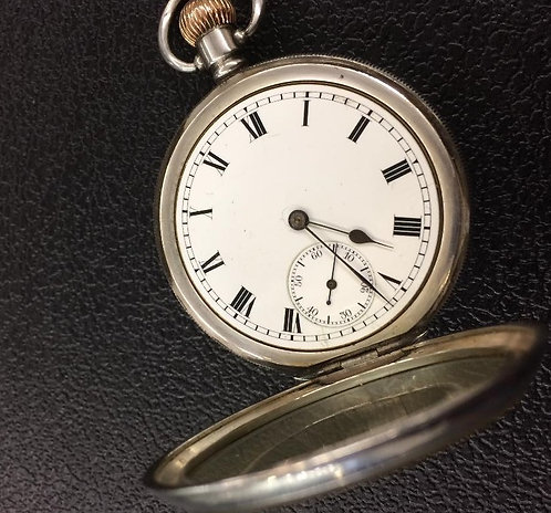 Silver pocket watch with Waltham Traveller movement 1913