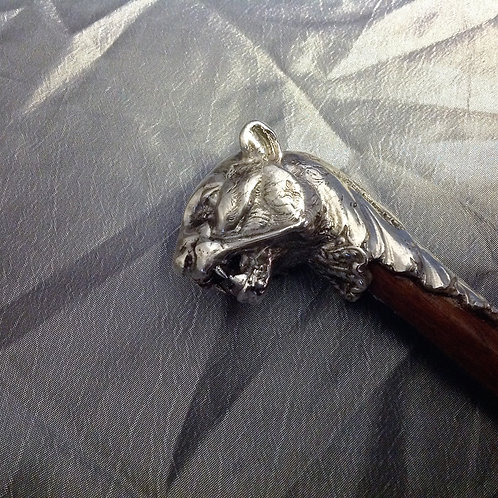 Silver tiger topped walking stick by Jon Braganza