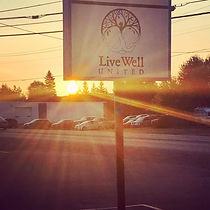 Sunrise behind LiveWell Sign