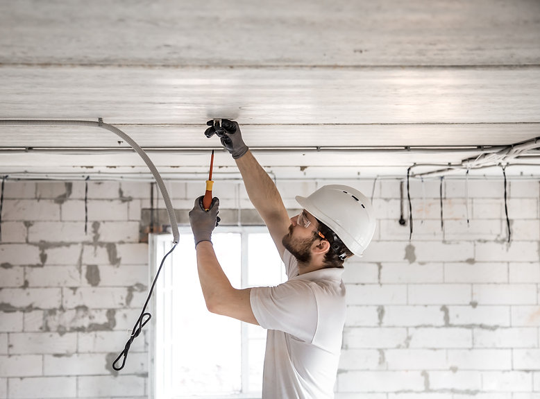 Electrician installer with a tool in his