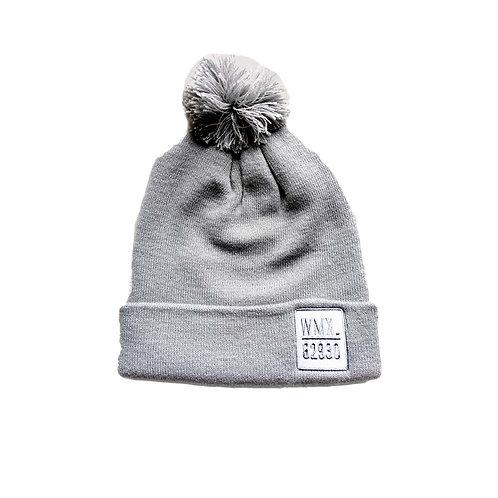 Bonnet à ponpon gris