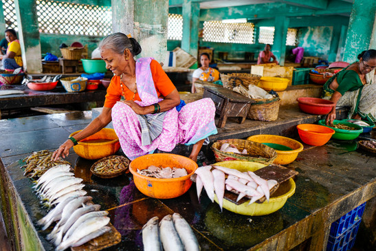 woman-sitting-near-fishes-and-basins-130