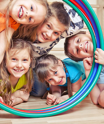Five cheerful kids looking through hula