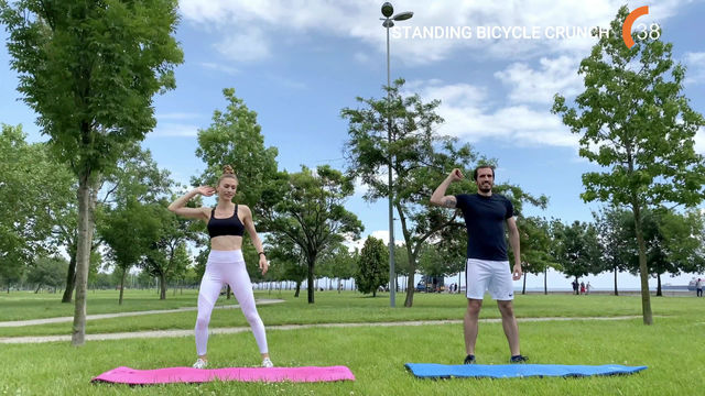 STANDING BICYCLE CRUNCH