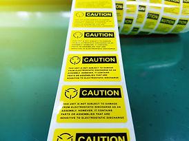 AS caution label roll AdobeStock_2315246