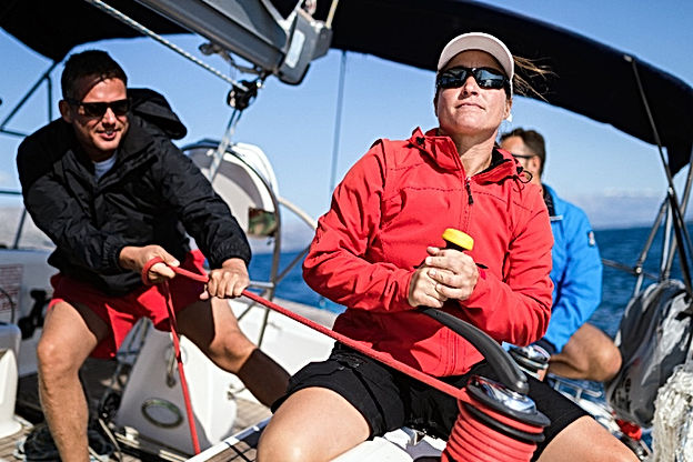 Attractive strong woman sailing with her