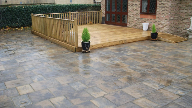 New rear paved garden complete with decking and disabled access