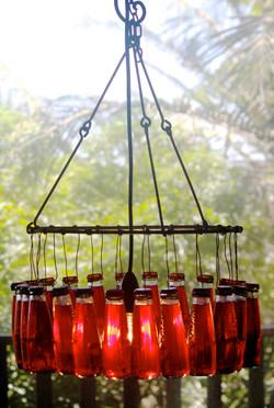 red bottle chandelier
