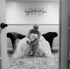 Wedding photo of bride getting dressed