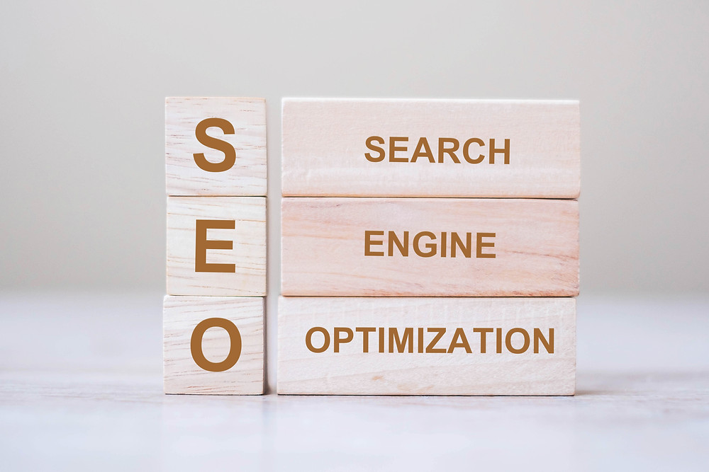 Wooden blocks with SEO search engine optimization written on them