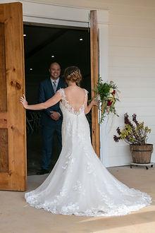 Bride opening front door.jpg