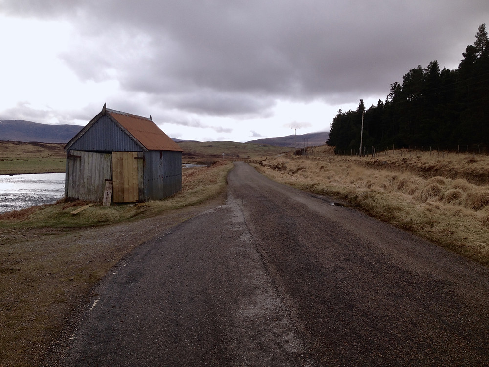 I was recently driving down the beautiful Strath Naver toward Altnaharra and as I drove  every forward into a raod the colour of skyclouds and fin scale underbelly silver, I found this shed again. I've always loved it and even more now it is the same colour as the landscape...
