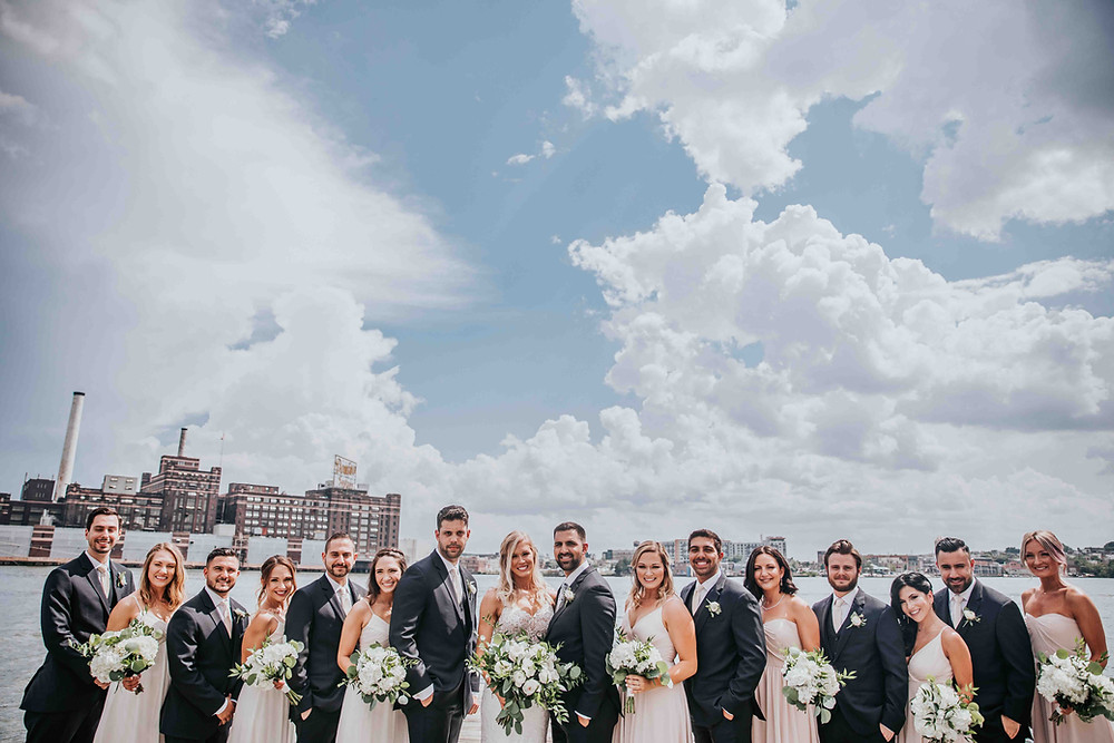 bridal party with domino sugar in background